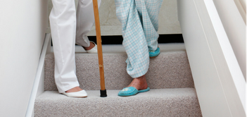 senior-caregiver-stairs-fall-prevention.png